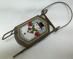 Sled  Ornament / Cross Stitched Snowman - pinned by pin4etsy.com
