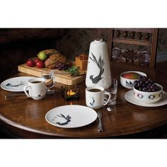 Gullfuglen (The Golden Bird) porcelain collection, pattern. Cup, plate, bowl and vase.