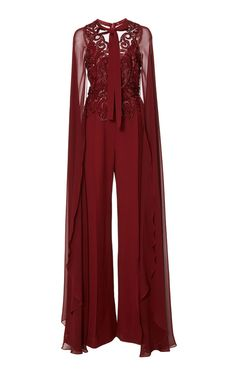 This **Elie Saab** jumpsuit features embellishment detail throughout, long cape sleeves, a necktie, and wide crepe caddy legs. Jumpsuit For Wedding Guest, Wedding Dress Chiffon, Wedding Outfits For Women, Indian Wedding Outfits, Lace Dress With Sleeves, Jumpsuit With Sleeves, Pink Bridesmaid Dresses Short, Hijab Evening Dress, Latest African Fashion Dresses