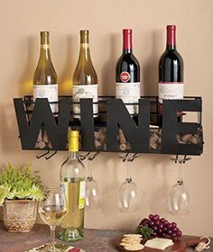 """• AN ORIGINAL DÉCOR IDEA: With its minimal lines, this beautiful wine rack that spells the word """"WINE"""" in bold black letters is a brilliant home décor idea that will make your living room or kitchen more classy and impressive with a single, albeit powerful addition! • SLEEK & ELEGANT DESIGN: They say that, when"""
