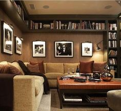 Finished basement with books.  Nice shelves and nice wall color.
