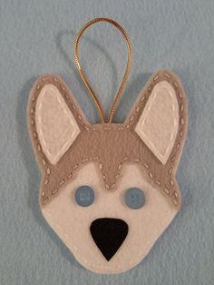 Cute felt Husky Ornaments! They are made out of felt and sewn with embroidery floss. Great to hang on the tree but also can hand on doorknobs or
