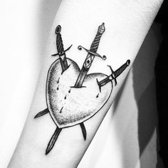 The Three of Swords delivers a powerful and slightly dark message, often representing physical and emotional pain. | 19 Powerful Tarot Tattoos