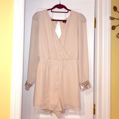 Nude summer plunge romper ✨ In great condition, just big on me now :) plunge neck, great for resort and summer ! You can easily dress it up or down. Has sequin cuffs ! Elastic band in the back for a fitted vest :) Forever 21 Pants Jumpsuits & Rompers