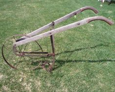 "An antique, manual, garden cultivator plow.  I used to play with a ""dull"" plow, like this,  at Grandmother's. These were used to plow fields for crops behind: mules, horses, oxen and people; if you were out of any of the first three. No fun!"