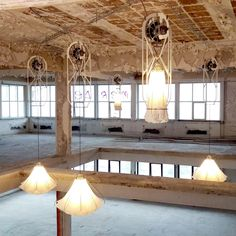 Studio Drift have installed moving Shylights in a disused Eindhoven building.