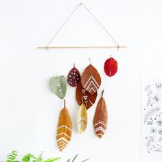 Tattoo autumn leaves and makes them into beautiful wall decor.