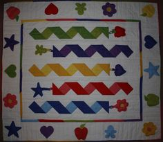 Baby quilt with attached toys