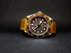 Tudor Black Bay Bronze diving watch with brown leather strap