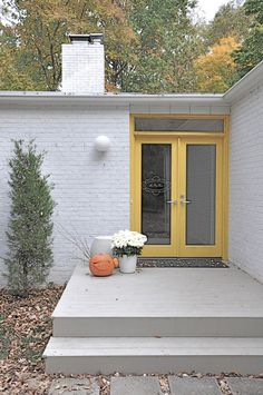 Have an original MCM door - brighten it with yellow.  Yellow front doors.  Mid-century modern. USA