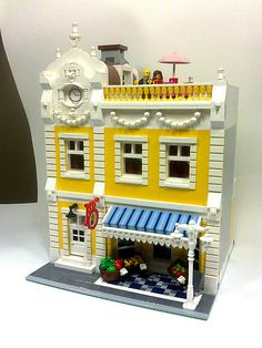 Excellent gingerbread detail using lamp holder bricks & more on St Times Yellow Grocery by marcosbessa