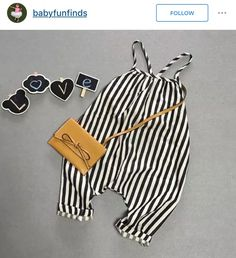 Grey background romper flat lay with props