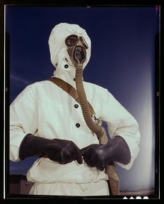 Sailor at the Naval Air Base wears the new type protective clothing and gas mask designed for use in chemical warfare, Corpus Christi, Texas. These uniforms are lighter than the old type. August photo by Howard R Hollem Hazmat Suit, Chemical Weapon, Colorized Photos, Corpus Christi, Illustrations, Library Of Congress, Dieselpunk, Mask Design, Warfare