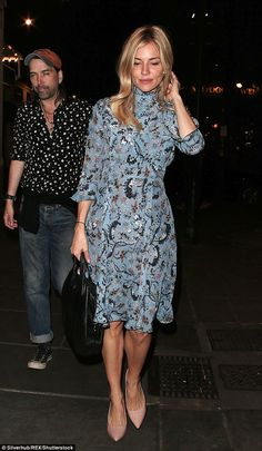 Glamorous: Sienna Miller was the picture of elegance as she left the Apollo Theatre on Thursday night, dressed to impress in a baby blue dress with pretty embroidered detailing