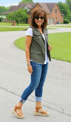 How to style a utility vest for spring. You see them everywhere--but what are you supposed to do with a utility vest? How should you wear it? Well, we like it paired with jeans and over a white t-shirt for an awesome, easy, breezy summer look.