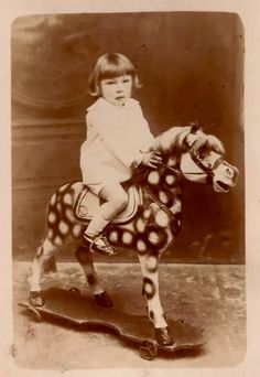 Remarkable vintage photo of a little boy on a spotted three-legged toy horse :)