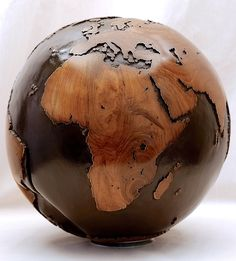 Hand carved wooden globe, made from reclaimed teak root.