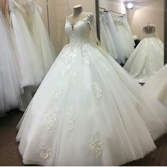 Curvy brides can have long sleeve plus size wedding dresses like this made with any modifications they need. In addition to custom #plussizeweddingdresses we can also provide inexpensive #replicaweddingdresses for brides who can't afford the original. Get pricing on any dress at www.dariuscordell.com/
