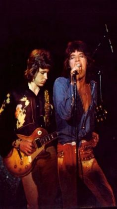 Mick's Jagger and Taylor performing live onstage, c. 1972