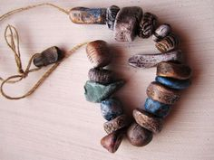 19 Antique Relic Carved Stone Pebble Precious Metal Effect Rustic Earth Woodland Hand Painted Porcelain Clay Beads No.87. £28.00, via Etsy.