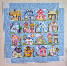 A purchased quilt-as-you-go design from Anita Goodesign. Utilizes applique, machine embroidery, and standard sewing techniques. Each block is appliqued, embroidered, and quilted separately, then...