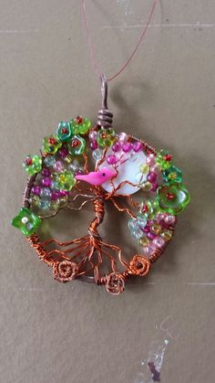 Tree of Life with glass beads and sea shell bird and Moon. made by Robin Allen