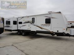 32ft - 2012 - Three Slide LaCross Luxury Lite - ONLY $25,995.00 You will see the country is comfort and style in this luxury bumper pull travel trailer by Prime Time!