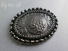 brooch with over 30 years of cameos wrapped in Toho beads frosted jet, sl gray, sl frosted gray, transparent gray and fire pilish frosted jet (5x6,5cm)