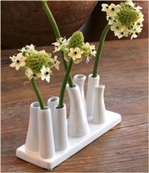Ceramic Multi Tube Vase with rectangular base with short tubes.
