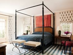 Playful bedroom with poster bed and patterns