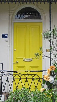 Yellow traditional front door