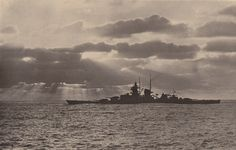 German battlecruiser Gneisenau silhouetted against a cloudy sky with the sunlight shining through.....