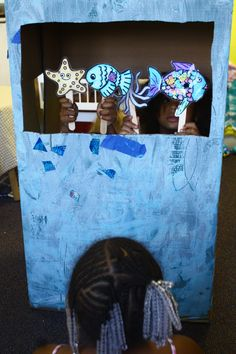 The kids painted and decorated a box that we turned into a puppet theatre for our Rainbow Fish puppet show!