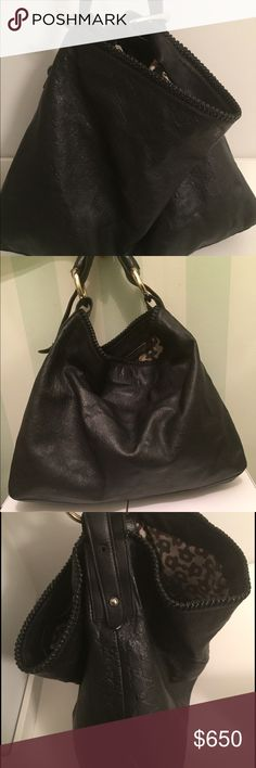 Black Gucci leather large hobo Gucci monogram 100% leather. This bag fits everything. Has 2 minor screws missing but can easily be fixed. Gucci Bags