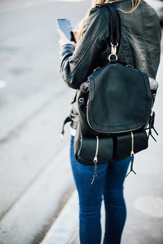 Chic Sole Society backpack with braided zipper pulls.