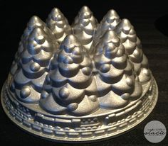 I have this pan and I love it. I make a spice cake and dust it heavily with powered sugar so it looks like it's snowed on it. Nordic Ware Holiday Tree Bundt Pan
