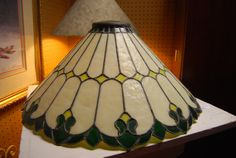 Antique stained glass lamp shade, very heavy. Can be seen at Gillespie Gardens on Facebook