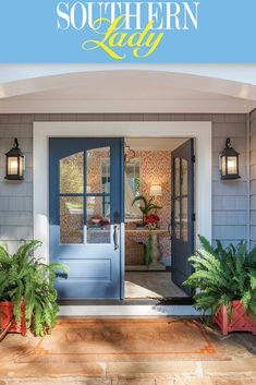 A playful coral patterned wallpaper compliments the cool blue tone of these welcoming doors. Carriage lights and verdant ferns frame the entrance way to create an inviting, contemporary look in this lakeside home. Repin for your own decoration inspiration and visit our website for a virtual tour of this lakeside home.