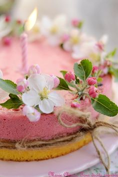 Strawberry cake with edible apple blossom