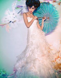 Origami ruffled wedding gown and Japanese umbrella  View the full wedding fashion editorial: Colours of Gion - Wedding Fashion - SingaporeBrides.com
