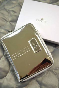 """Brand New """"Swarovski"""" Shiny Silver Metallic Wallet with 34 Swarovski Crystals at the Front - Wrap Around Zipper Closure - Interior Has 4 Card Slots and Coin Compartment - Comes with Box - W x D x H 4 H, Swarovski Crystals, Jewerly, Metallic, Closure, Zipper, Purses, Wallet, Interior"""