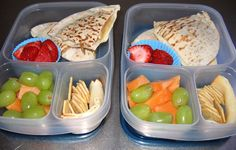 In your lunch box: PBJ and banana served in a pita, Fruit, crackers and a slice of rolled up turkey