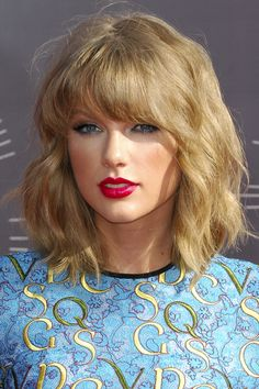 Everyone In Hollywood Has This Hairstyle — Here's Why #refinery29  http://www.refinery29.com/2014/09/68161/celebrity-blonde-bob-hairstyle#slide7  Taylor Swift's cut is between a baby bob and a lob, and those heavy bangs work well with her curls.
