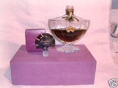 vintage Shalimar -A very rare presentation, called thePresentation Avion(airplane transportation presentation), used this style of box and wasofferedon theAir France Paris-New York flights, starting in 1960. The stopper was not inside the bottle itself but was inside a tiny cardboard box which was included in the presentation box. The perfume was sealed with a cork covered in a thin plastic seal. These bottles were made by both Baccarat & Pochet et du Courval.