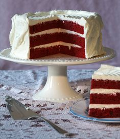 This is a cake to stop traffic The layers are an improbable red that can vary from a fluorescent pink to a dark ruddy mahogany The color, often enhanced by buckets of food coloring, becomes even more eye-catching set against clouds of snowy icing, like a slash of glossy lipstick framed by platinum blond curls