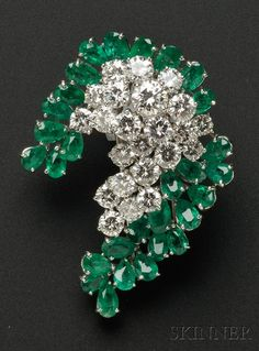 CARTIER 1970s . Platinum, Diamond, and Emerald Brooch, prong-set with circular-cut diamonds and pear-cut emeralds.