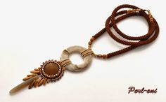 Perl-eni | bead crochet rope with peyote bails, donut and bead embroidered or beaded bezel cab.