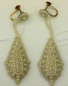 Pair of pearl pendant earrings with screw backs, European, 1860-65. Part of a jewelry set, along with a pearl necklace with baroque floral design.
