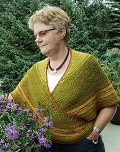 Traditional tie/work shawl in the Nordic tradition; all garter stitch with a unique crocheted edging, and ties on the ends so that you can cross the ends across your chest and tie in back around your waist to keep the ends out of the way.