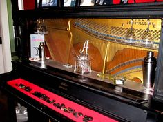 """We bought an old piano at the thrift store and made it into a """"piano bar"""""""